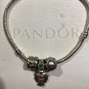 Pandora bracelet sterling silver with 3 charms.